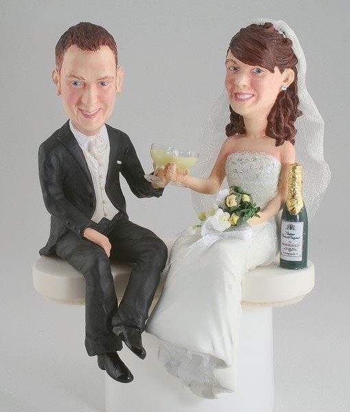 The ultimate in hand sculpted wedding cake toppers and caricature figurines.