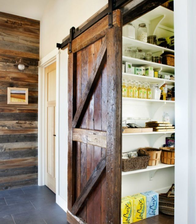 Sliding door and wood accent wall. I must have a barn door somewhere in my house!