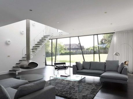 Architecture Awesome Unique Black And White House Design In Kent England Featuring Modern Grey Sofa Floating Fireplace Living Space With
