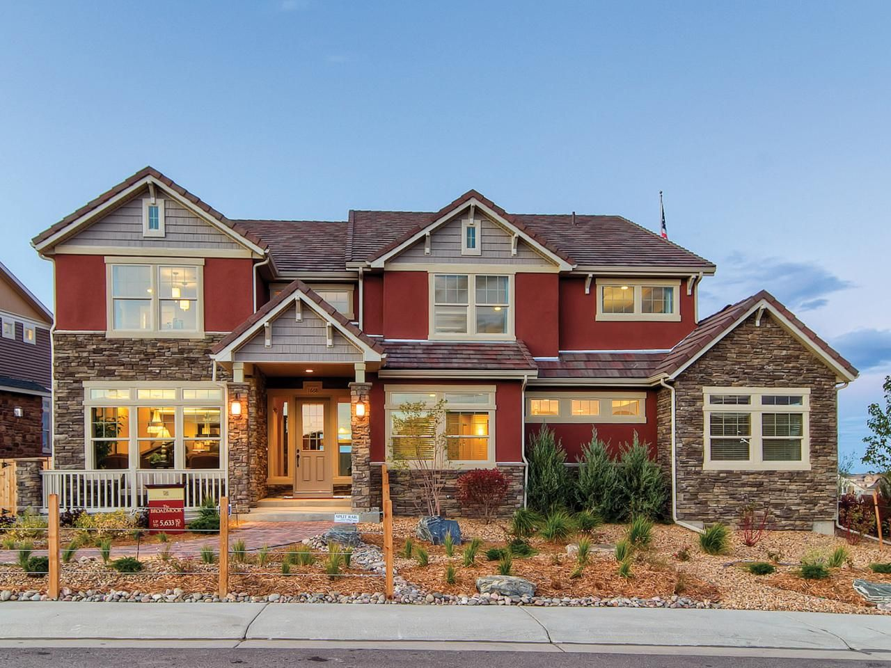 Red House with Siding and Stone Exteriors