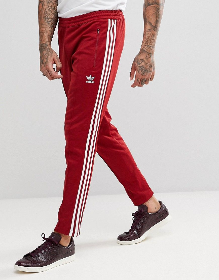 80eafaebf428 ADIDAS ORIGINALS ADICOLOR BECKENBAUER JOGGERS IN SKINNY FIT IN BURGUNDY  CW1270 - RED.  adidasoriginals  cloth