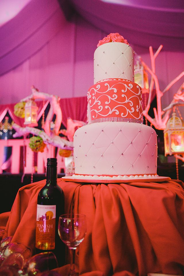 The debutantes threetiered cake was a an eyecatcher on its own