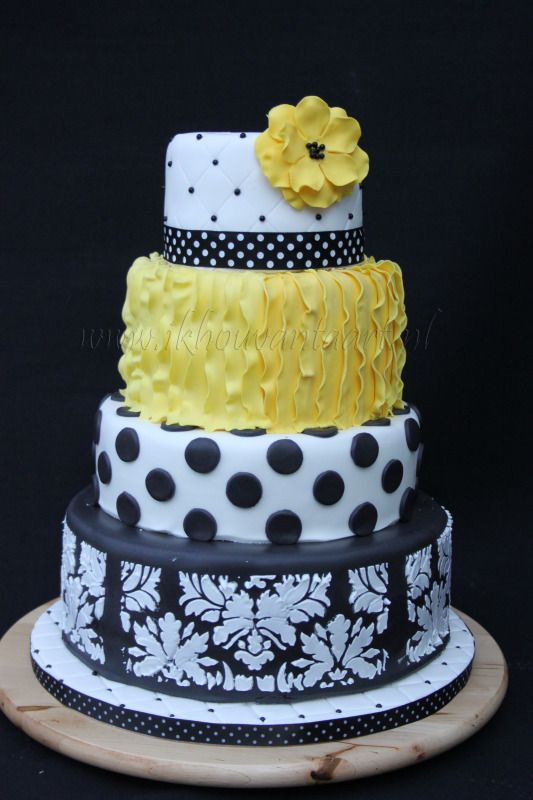 black white and yellow wedding cake. I would like it more if it was gray & not black