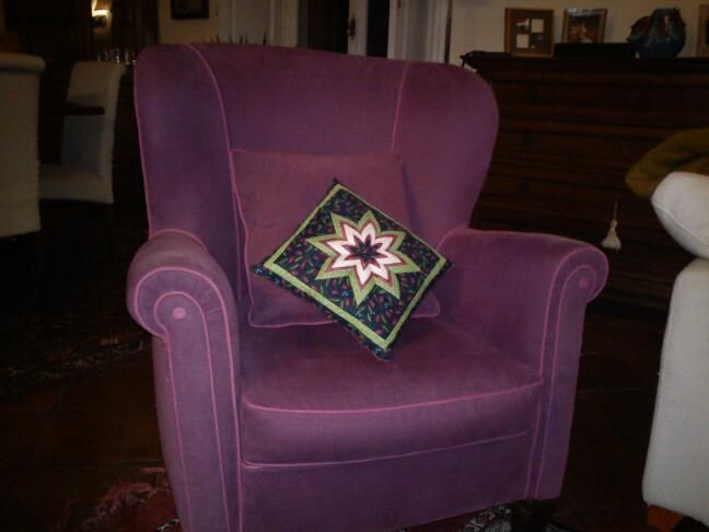 December 2012 - A cushion with the first folded star I made.  Many more stars followed, but there's always a special place for this one.