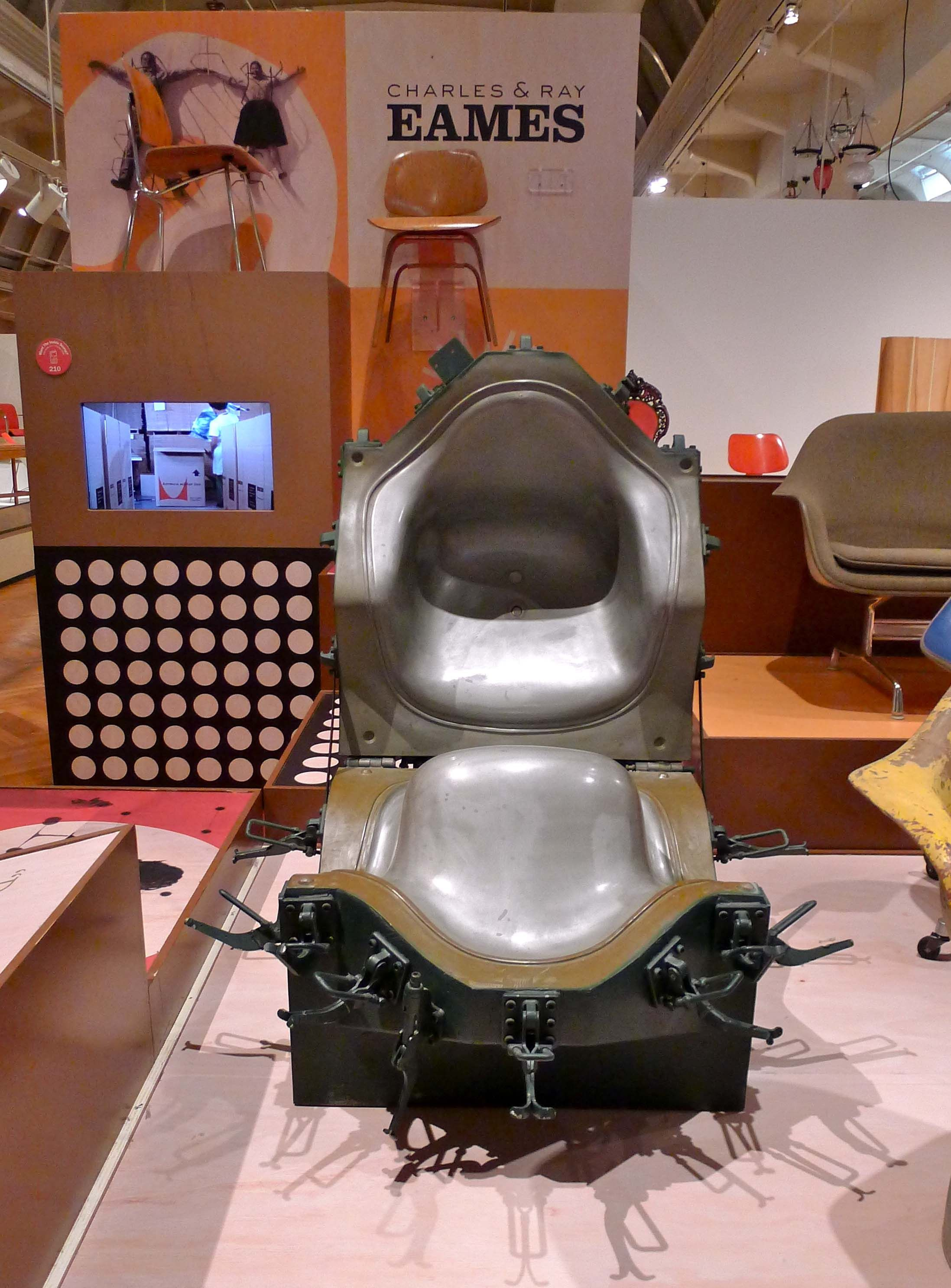 Vintage machine for applying upholstered pads to Eames fiberglass