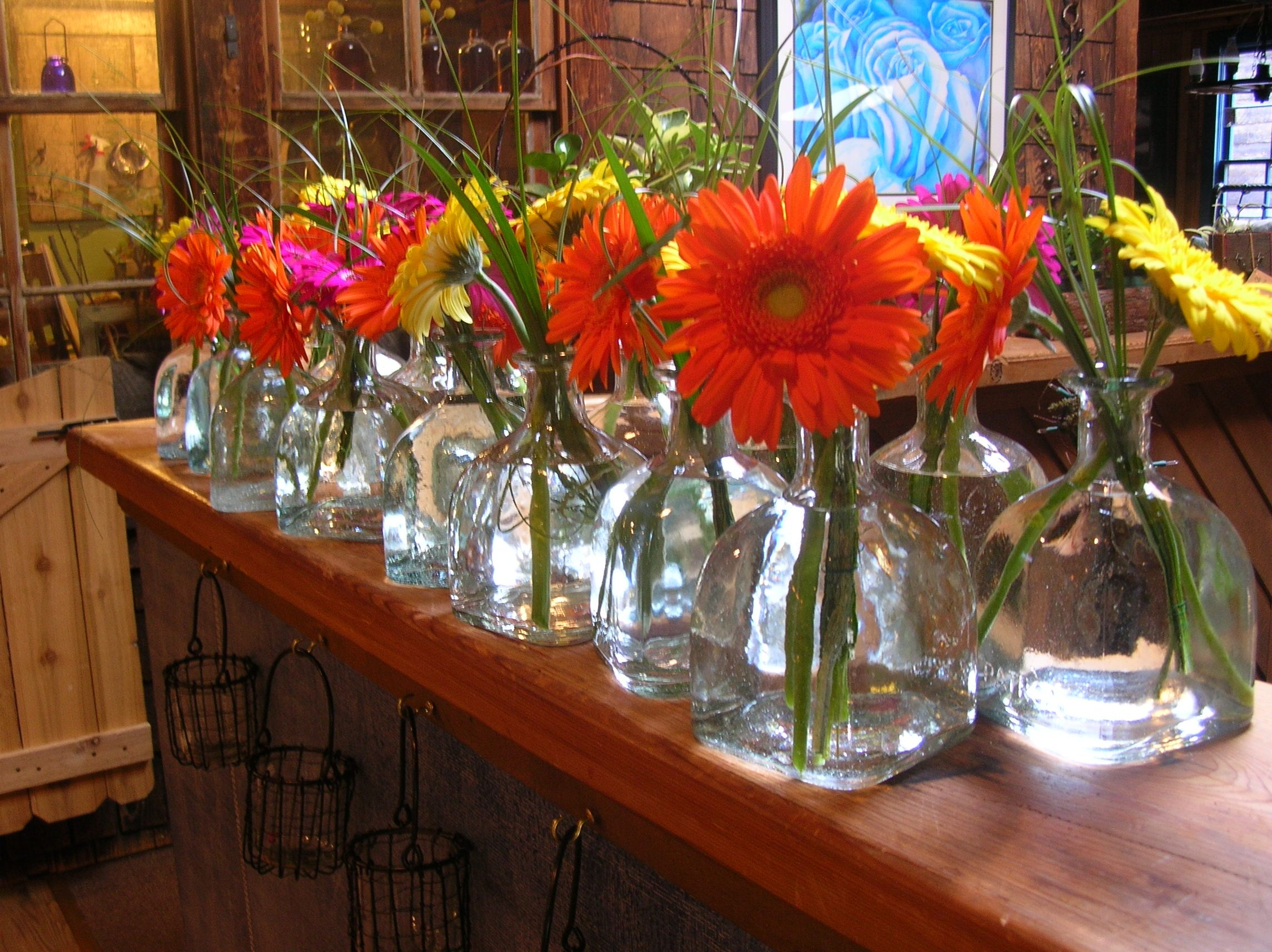 Patron Bottles For Simple Wedding Centerpieces~ Stems Flower Shop