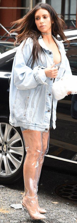 The Perspex footwear looked far from comfortable, and they may have been as the wife of Kanye West seemed a bit dismayed as she left a building with the assistance of a bodyguard.