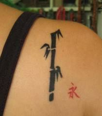 Small Black Bamboo Tattoo On Back Shoulder Tattoo Ideas
