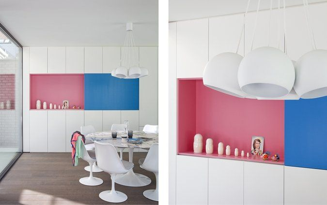 Eetkamer met roze en bauw gewaagd maar geslaagd home