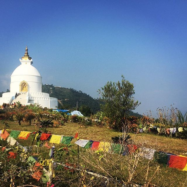 Today marks one year since the devastating earthquake in Nepal. Thinking of the wonderful people and their beloved country.  #lovetonepal #ddRoams #didianddhai  #world #peace #pagoda #pokhara #nepal #asia #travel #send #love #thoughts #nepalnow #dktm #instanepal #prayer #flags #mountain #top #phewa #lake #hike