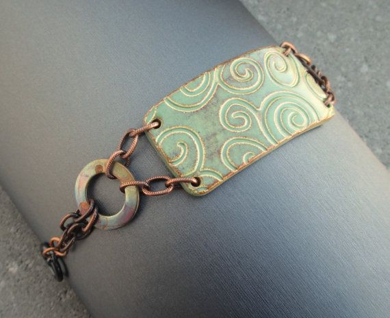 I used a pottery cuff piece for the focus of this bracelet. It has a swirl pattern imprinted on the surface and the color is green with some bown