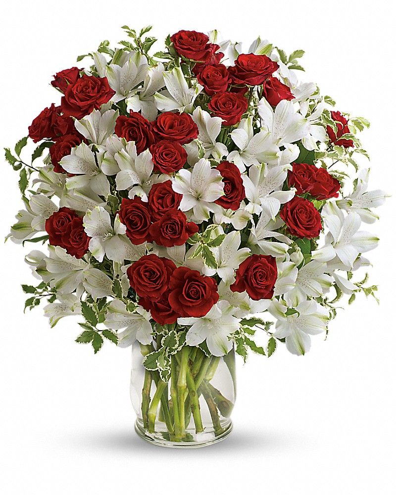 awesome Endless Romance Bouquet Roses and romance - a match made in heaven. Our endlessly elegant bouquet combines passionate red roses with heavenly white blossoms in a stylish glass hurricane vase. What a classic way to say you care!