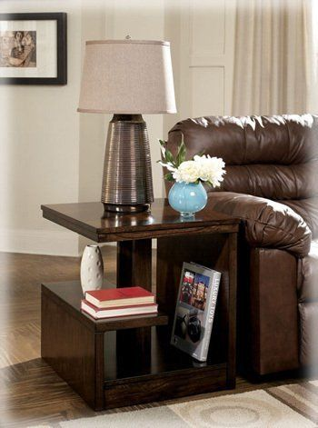 """Callum Modern Rectangular End Table by Famous Brand Furniture. $170.77. Shelfs for additional storage. Rich brown finish. 22.63"""" W x 26.56"""" D x 25"""" H. Unique cantilever design. Modern sophistication. This unique """"Callum"""" accent table end table will be sure to get attention in any sophisticated living space. The rich, dark brown finish beautifully highlights the intricate cantilever design and shelves which make this table as functional as it is stylish. End table only. Matchi..."""