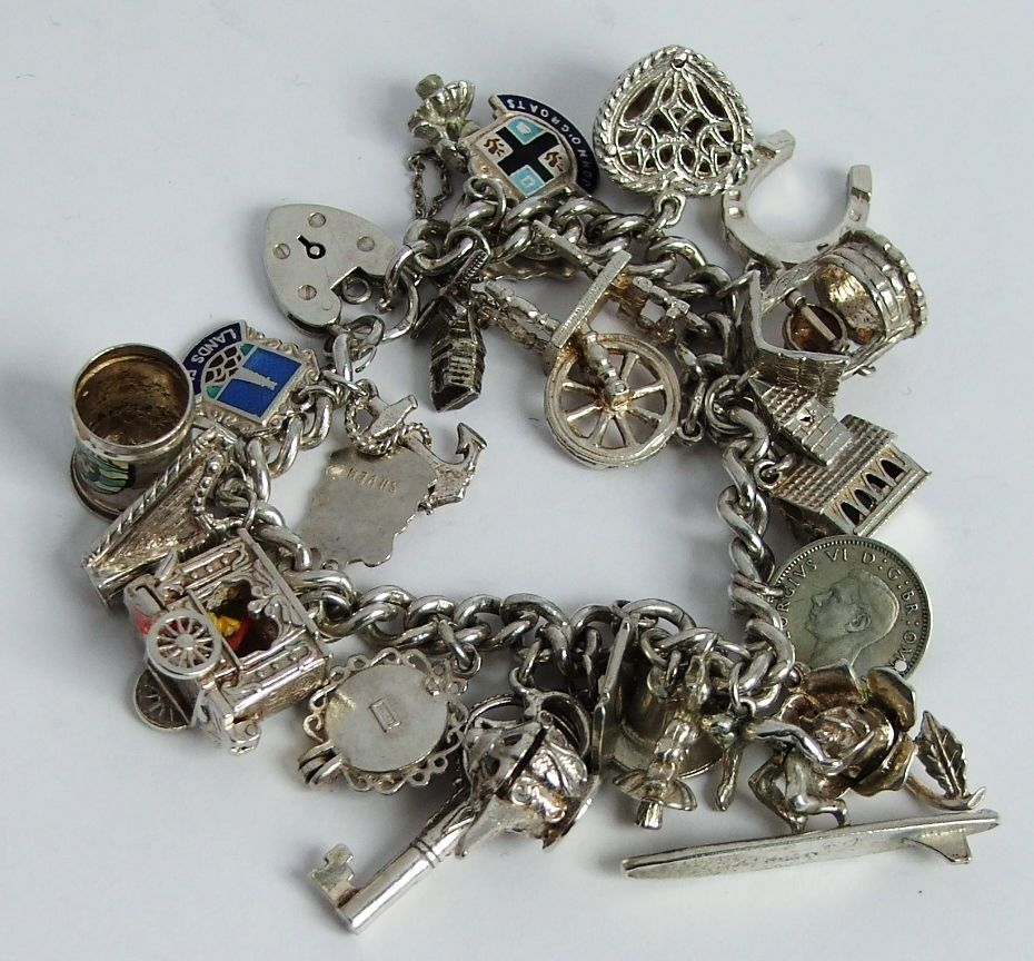 Fabulous solid sterling silver charm bracelet & 24 charms.Moving / opening, 1966