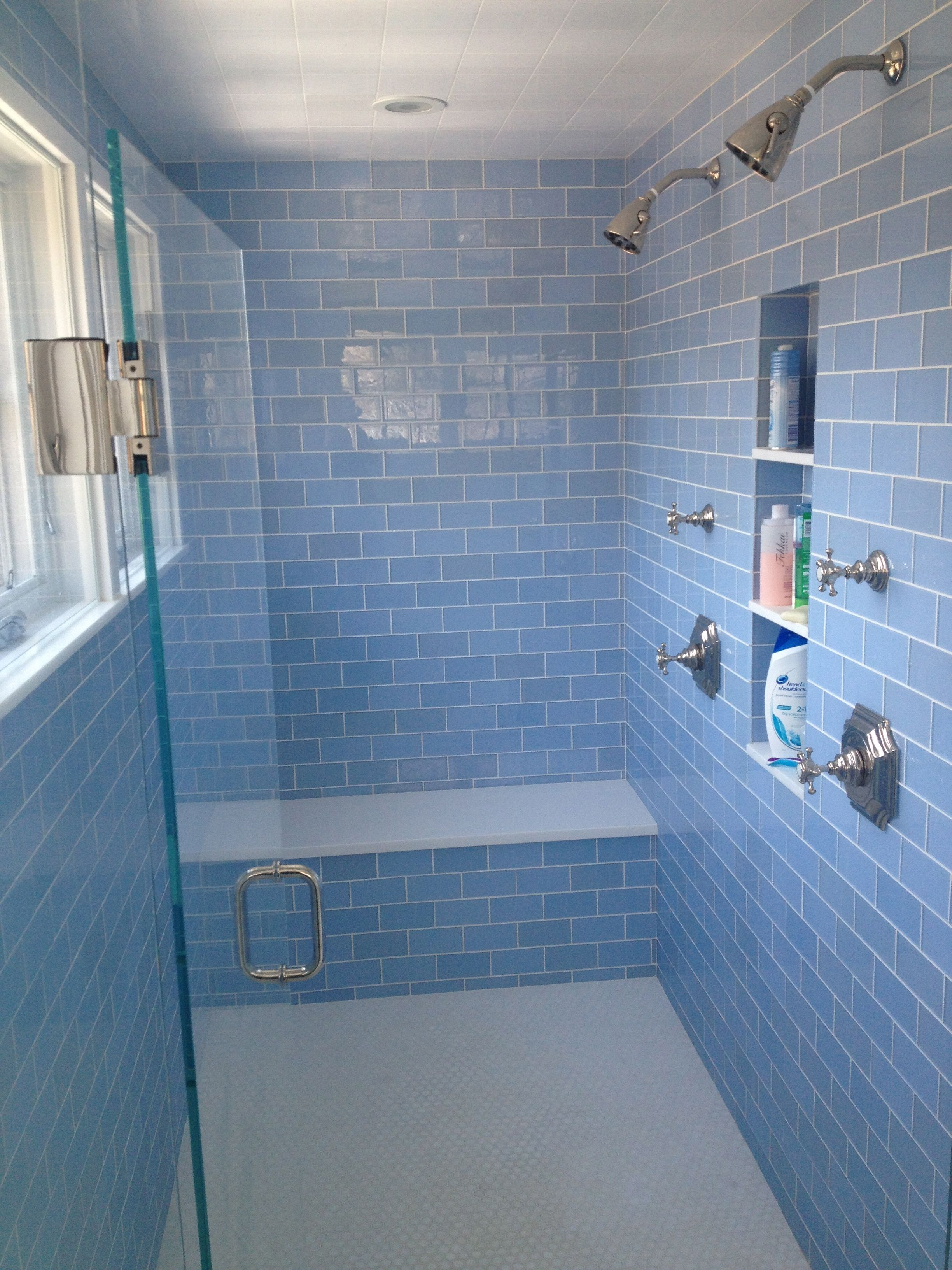 Master Bathroom- waterworks fixtures with blue glass tile ...
