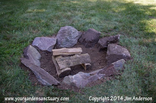 Shows how to build a cheap easy fire pit for your backyard for Make a fire pit cheap