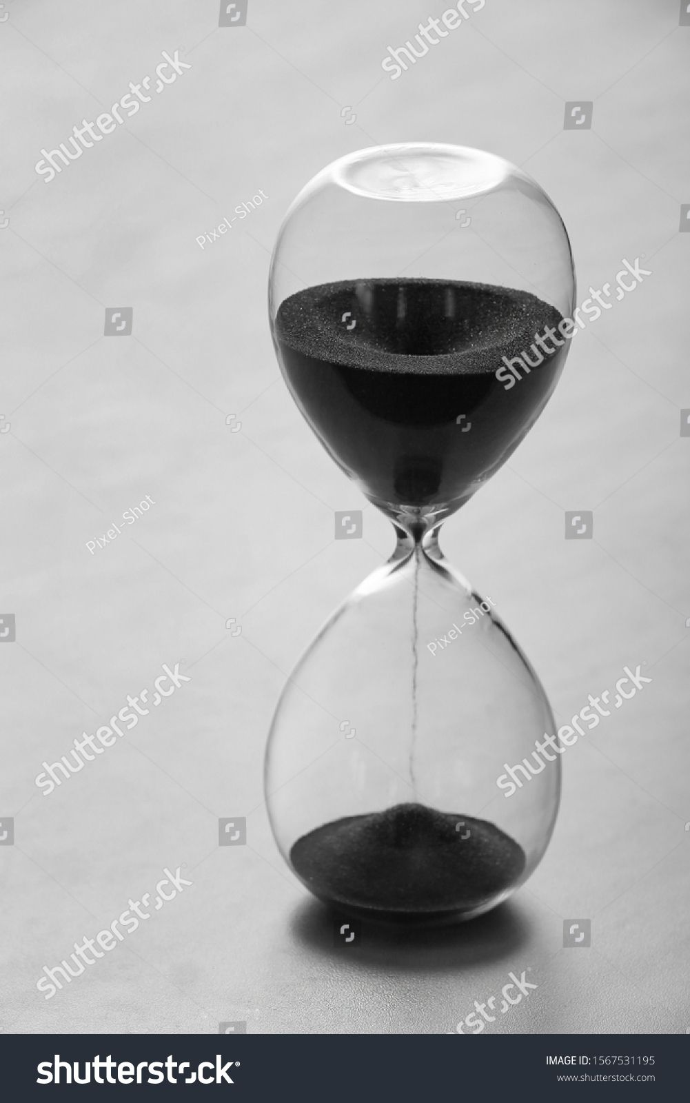 Crystal hourglass on light background