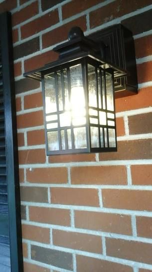 hampton bay exterior wall lantern with built in electrical outlet gfci hampton bay mission style black with bronze outdoor highlight wall lantern builtin electrical outlet gfci 30264 at the home depot mobile