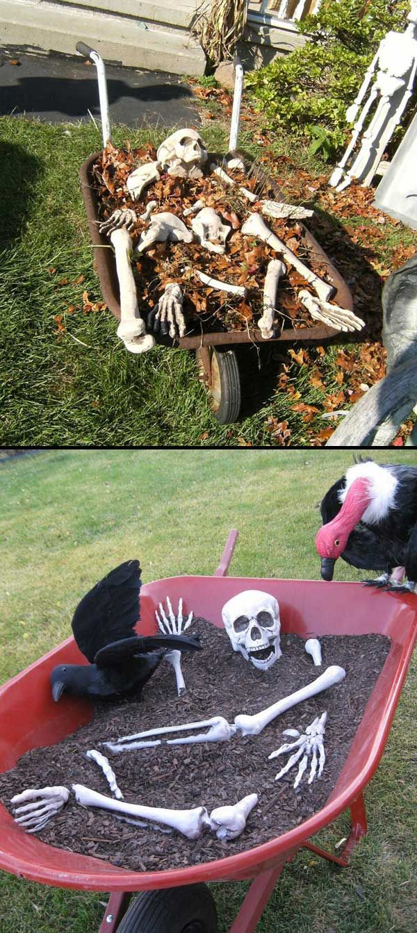 This wheelbarrow carring lots of bones can help bring a bone - Halloween House Decorating Ideas Outside