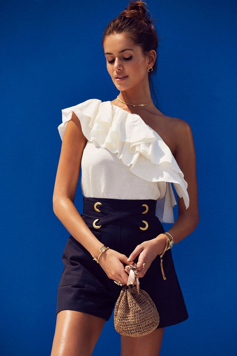8fa0003ca7ee Vacation season is here and REVOLVE provides some serious inspiration with  the release of its  Santorini Siren  style guide featuring summer looks to  cool ...