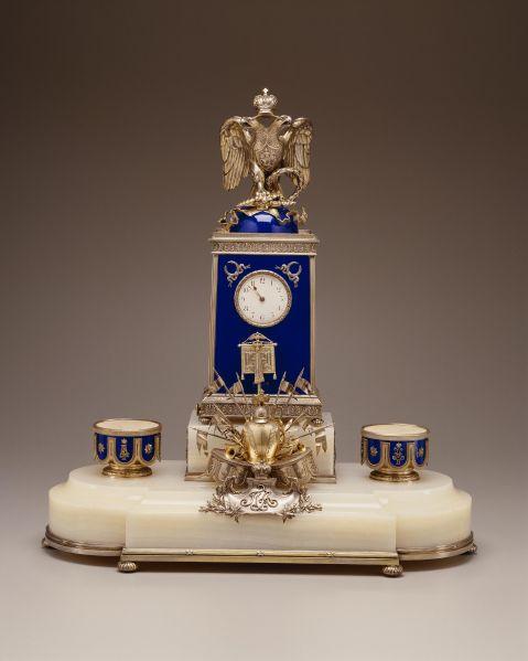 Regimental Desk Clock, Fabergé (firm); Rappoport, Julius (workmaster) RUSSIA: Moscow Ca. 1896 Silver gilt, enamel, marble