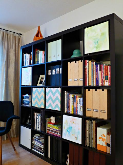 IKEA Hackers: Artful Expedit covering area with decorated canvases. Could use photo canvases