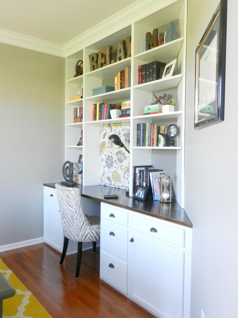 Built in desk and bookshelves on odd angled wall