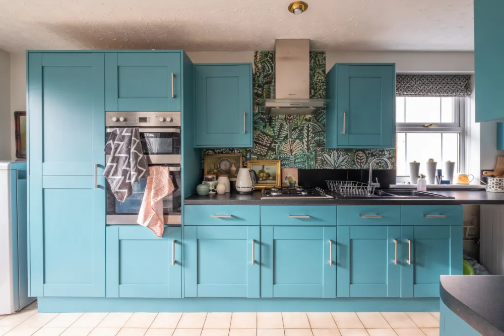 A BookFilled Maximalist Home Has MustSee Blue Kitchen