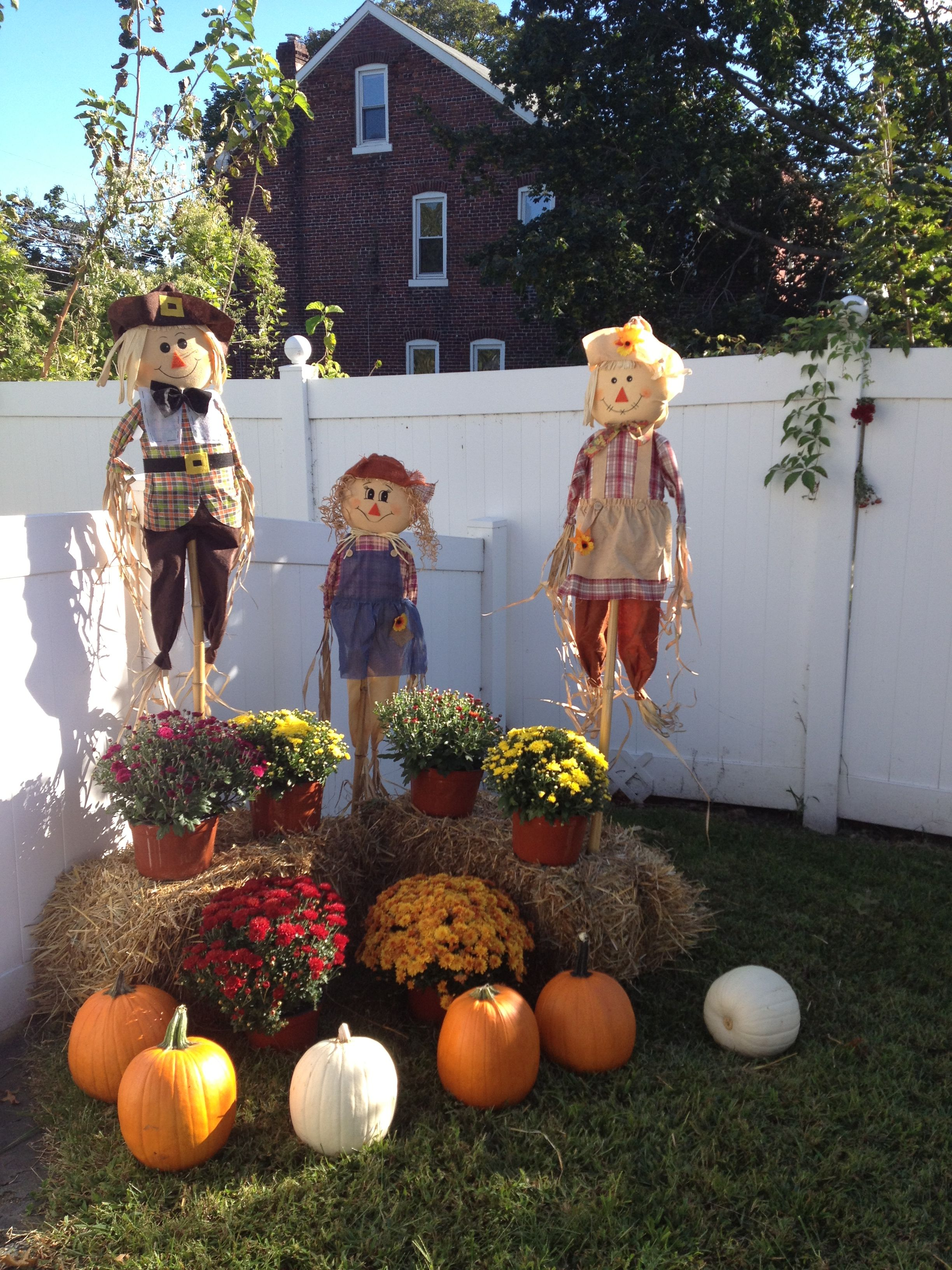 Outdoor Mums Pumpkins And A Family Of Scarecrows Pumpkin Fall Decor Fall Outdoor Decor Outside Fall Decorations