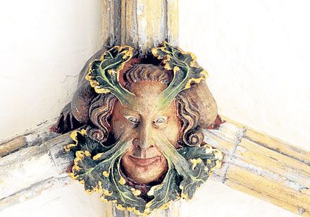 Carving of vegetation growing from a man's face is fixed to the roof at Norwich cathedral. The cathedral has 1,016 roof bosses, the carvings on the underside of heavy keystones in the roof vaults.