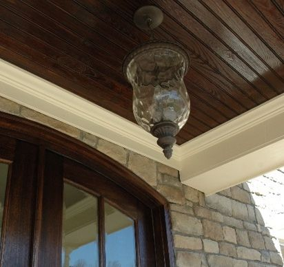 Dark Stained Beadboard On The Ceiling Of Covered Patio