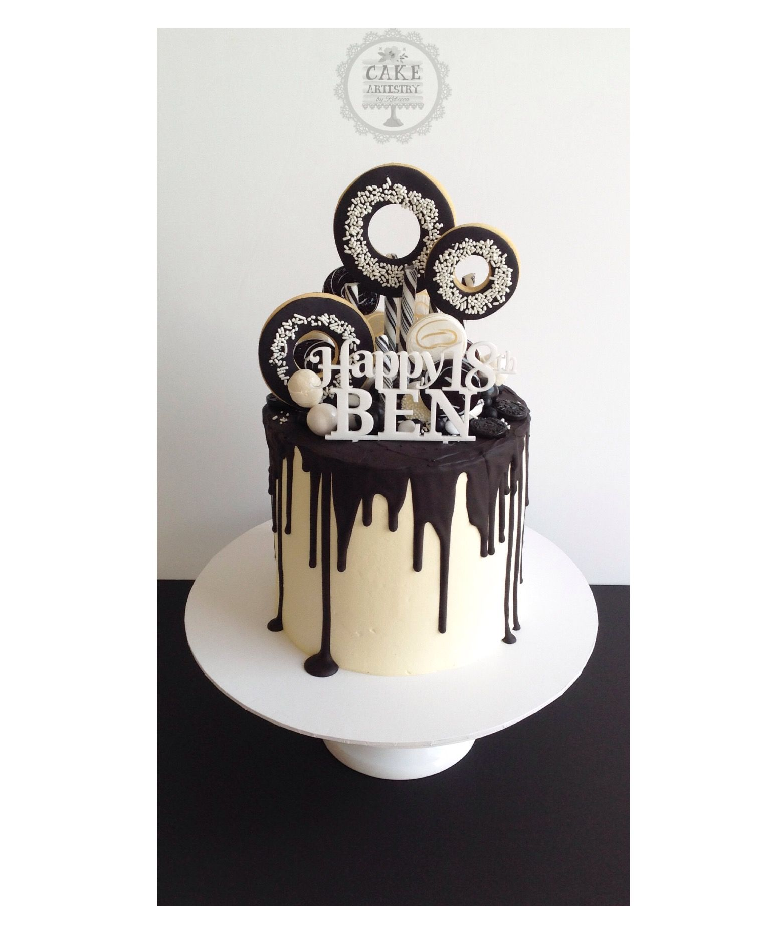 Black And White Drip Cake With Doughnut Cookies And Black