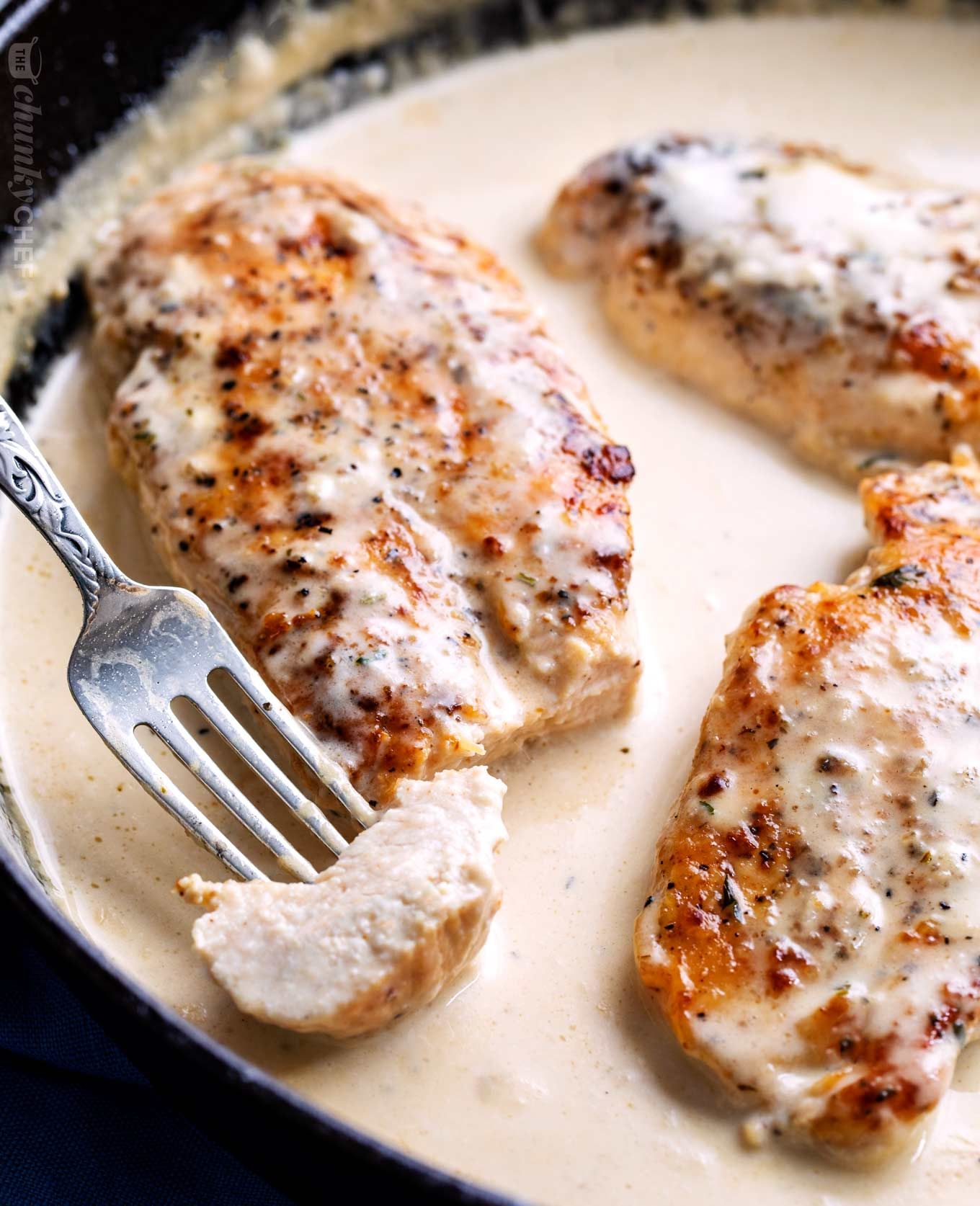 Tender Chicken Breasts Smothered In A Rich Garlic Cream Sauce All