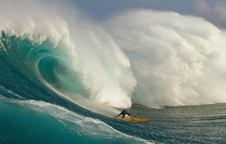 surfing massive wave