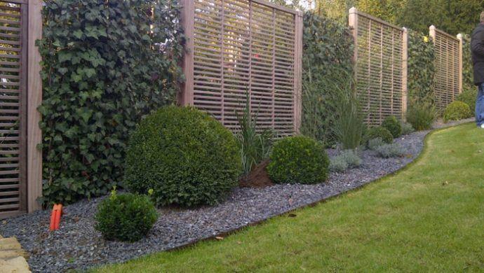 Photo of Die Klassik der modernen Gartengestaltung: Holzzaun