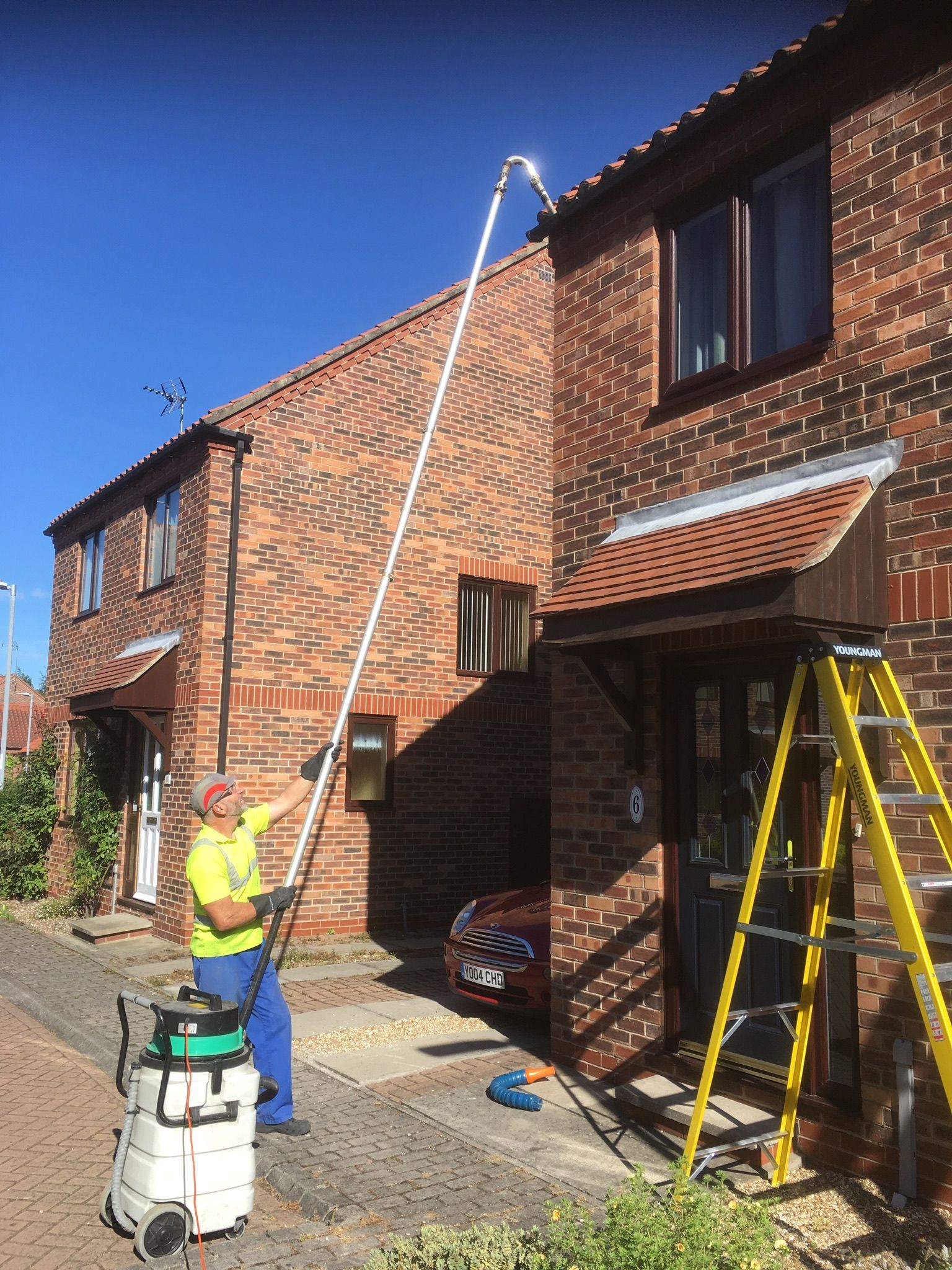 Cleaning gutters using our new gutter vac machine a cost