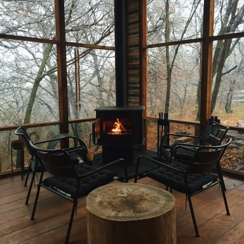 wood burning stove on the cabin screened porch