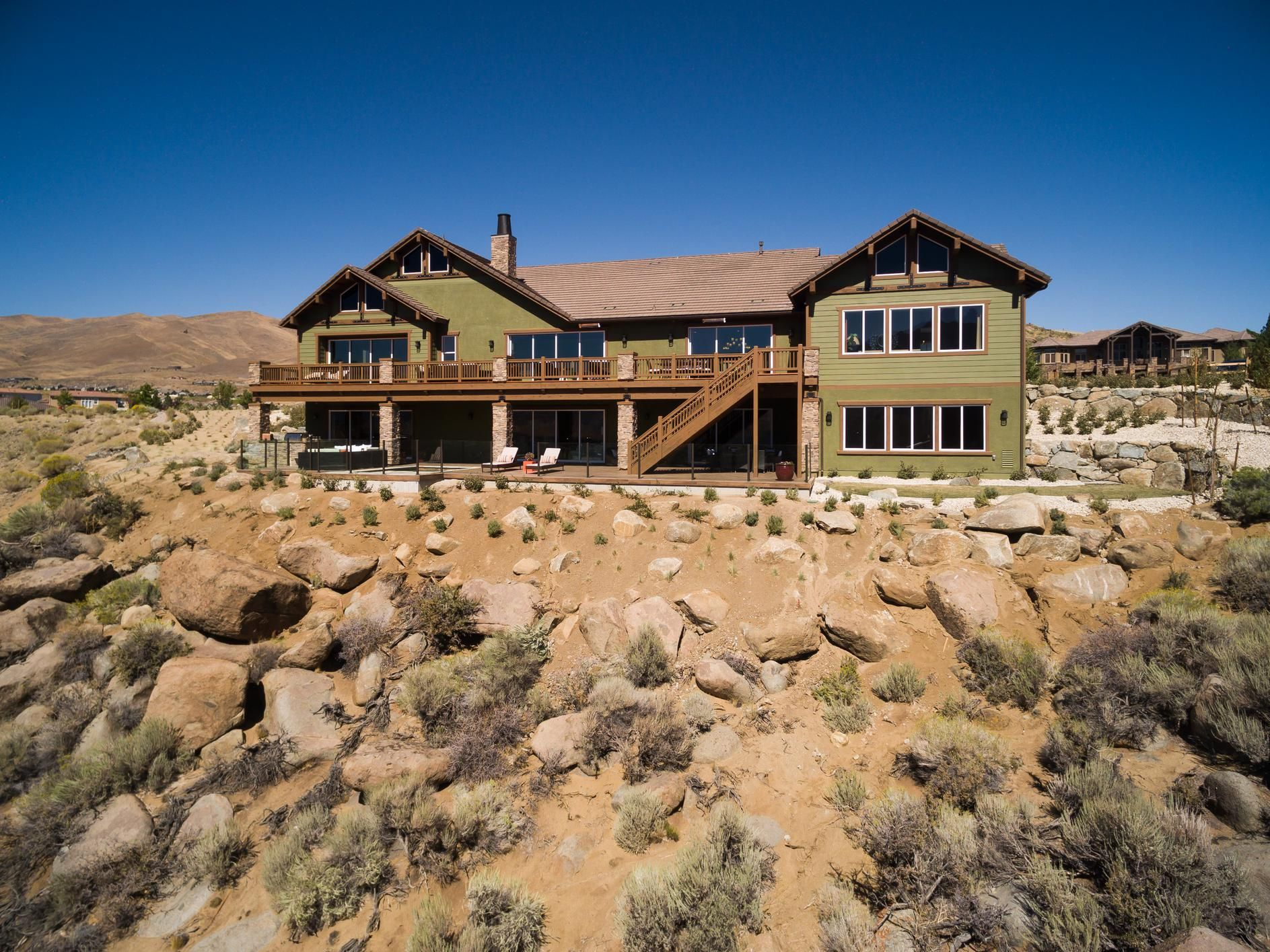 Design A Luxury Home Surrounded By Nature Featuring The Boulders At Somersett Ranier Model Home Located In Reno Nev Model Homes Luxury Homes Home