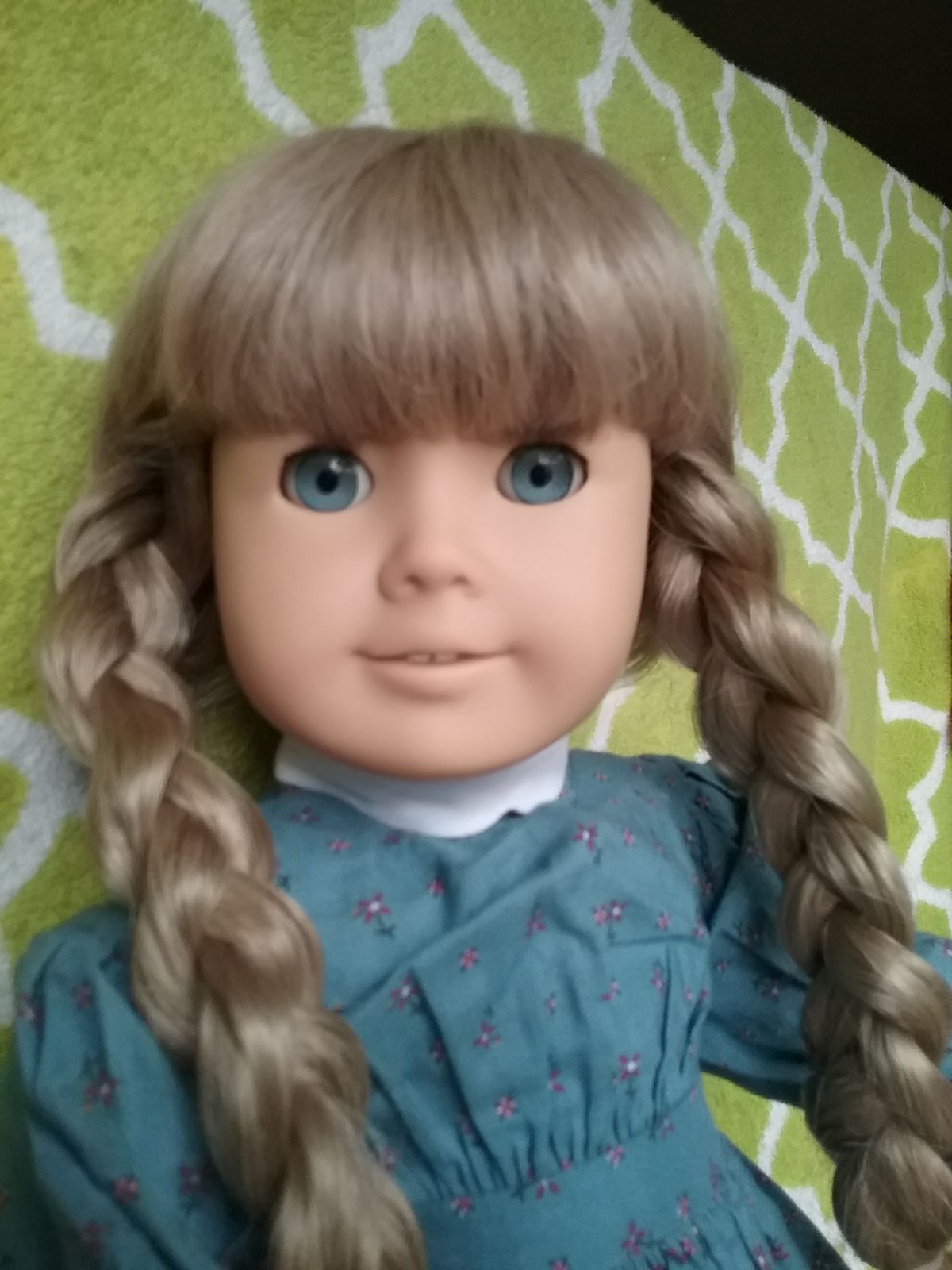 How do i identify an american girl doll? - Asked by emmesattic