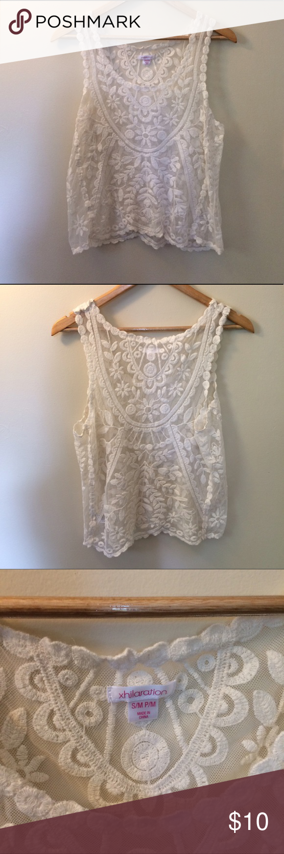 Boho Lace sleeveless shirt This shirt has a Bohemian, romantic, elegant look. It can easily be dressed up or down! Length from top to bottom is 23 1/2 inches. Length across the midsection is 19 inches. Tag says this is a S/M or petite M Xhilaration Tops Tank Tops