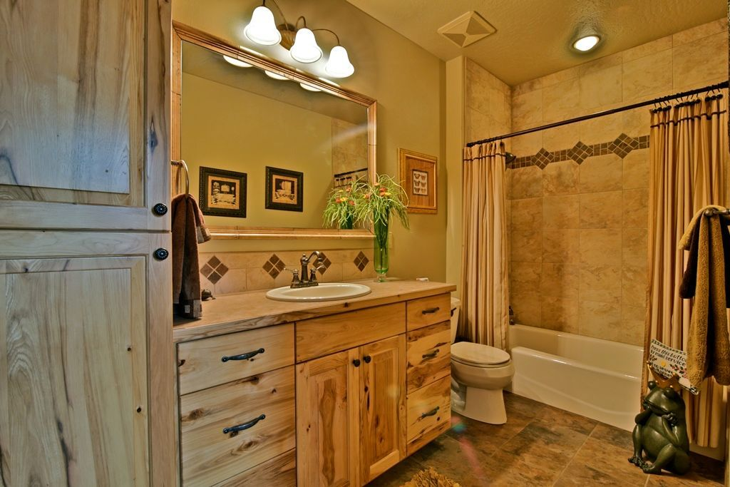 rustic full bathroom with slate tile floors european