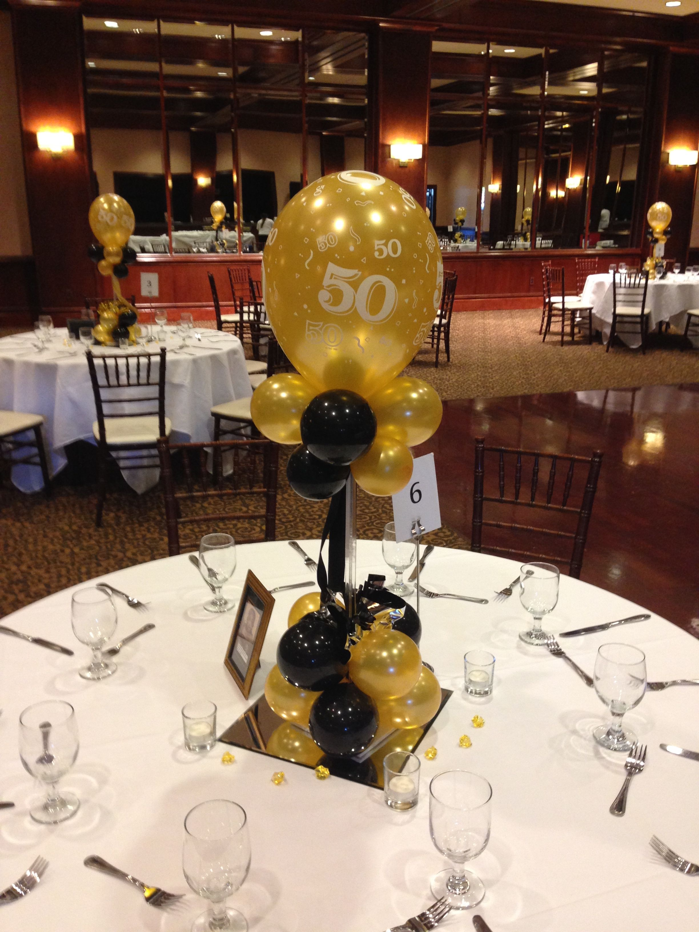 Black and gold balloon centerpieces for a 50th birthday or for 60th anniversary party decoration ideas