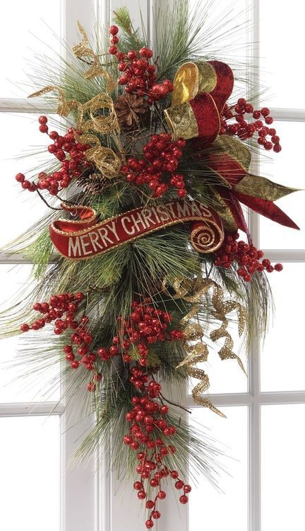 Evergreen branches, red berries, a gorgeous ribbon...a really beautiful alternative to a wreath on the front door.