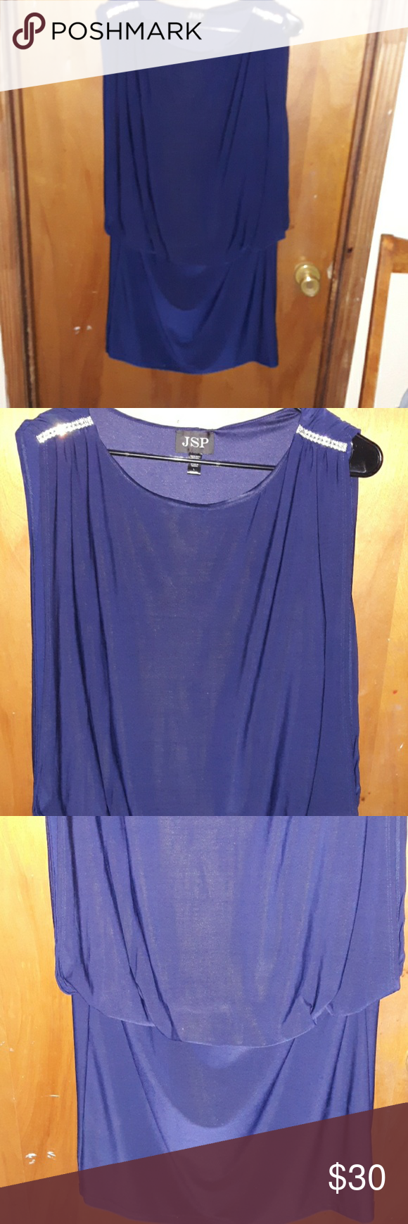 JSP Navy Blue Casual Dress Pre-owned in great condition.  Used once for a wedding.   This is a Navy Blue Sleeveless Short Dress, fitted below waist with double layer of rhinestones on each side of shoulders. 100% Polyester  Size Large (Stretches) Approximately 26 from armpit to bottom.  In some pictures it may appear royal blue but the true color is Navy Blue. JSP Dresses Midi #navyblueshortdress JSP Navy Blue Casual Dress Pre-owned in great condition.  Used once for a wedding.   This is a Navy #navyblueshortdress