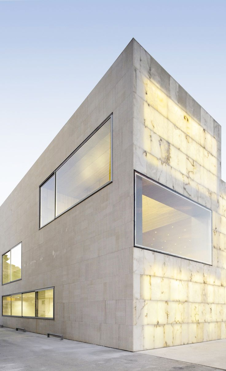 glowing stone like bineke library in reverse regional center for the development of local alabaster in hijar spain by magen arquitectos