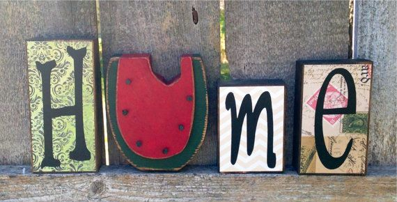 Chunky wood home block set with interchangeable primitive seasons shapes, including a pumpkin, watermelon, snowflake and flower. Cut from 2 pine,