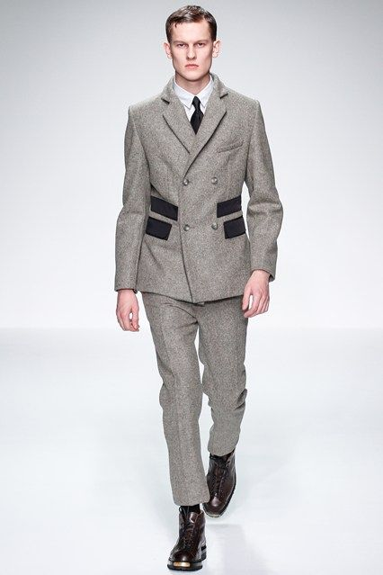 Lou Dalton Men's Fashion Week London Collection. Bespoke HQ love the design of the suit, which is similar to the overcoat, and the colour scheme for Lou Dalton's AW13 collection is fabulous - she has used slate grey's, greens and blacks to emphasize the theme and inspiration of oil.