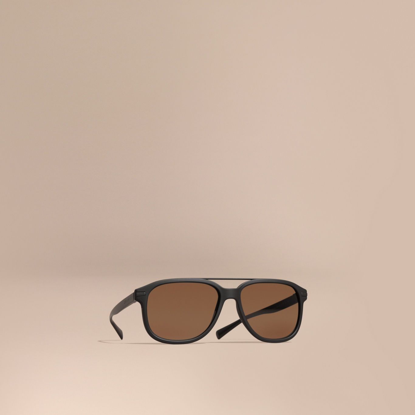 443a9903c40a Italian-made sunglasses in matte black acetate with a square frame and top  bar.