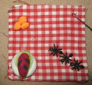 picnic swap is made with model magic clay a cotton swatch attached to foamie and plastic ants