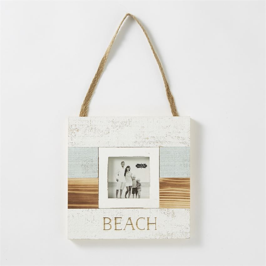 Painted planked wood frame features etched \'BEACH\' caption. Frame ...